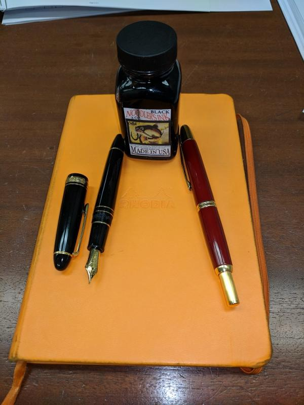 Pens and notebook small.jpg